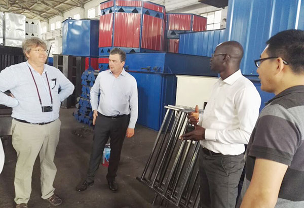 French customers are visiting peanut machines production factory